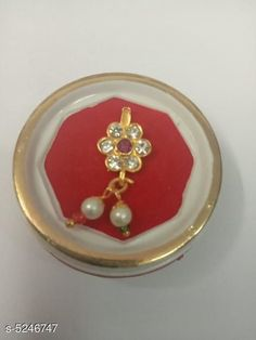 Nosepins Women's Alloy Gold Plated Nosepins Base Metal: Alloy Plating: Gold Plated Stone Type: Artificial Stones Multipack: 1 Sizes: Free Size Country of Origin: India Sizes Available: Free Size   Catalog Rating: ★4 (370)  Catalog Name: Women's Alloy Gold Plated Nosepins CatalogID_777525 C77-SC1099 Code: 041-5246747-042