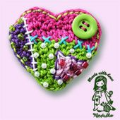 Isn't this fun, crochet, cross stitch, beads and button.....