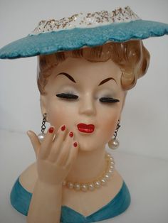 Love lady head vases...my grandma had a huge collection she called her ladies... i loved the ones with the real looking eyelashes, necklaces and ear rings
