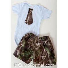 Where there's a baby, there's always a place for camo!  Just think of how sweet he'll look when wearing this diaper shirt, sewed on tie and short combo!Available in all camo prints.  Sizes 3months-18months.Made in the USA.