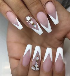 Matte triangular tip nails with accent nail.