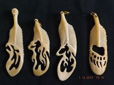 Eagle:bear bone, Bear and Bear paw:bear bone , feathered pendants ...$80.oo:: wolf in feather has been sold