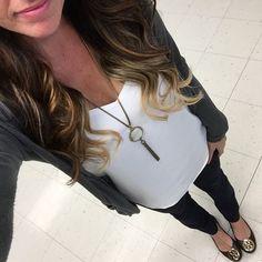 Black cardigan + Express Barcelona Cami in White + pendant necklace + black skinnies + flats [@teacherfashionista]