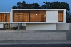Modern two level concrete house by dEMM Architects