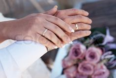 Stock image of 'Male and female hands with wedding rings In the background, wedding bridal bouquet'