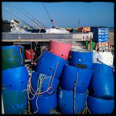 Bright blue fishing buckets on the beach at East #Worthing @Ivy Arch
