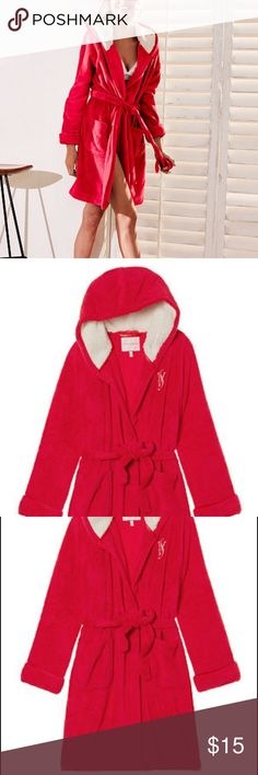 """Plush bathrobe Victoria's Secret Soft and warm in plush fleece, with a faux-fur lined hood, cuffed sleeves and a tie, this short robe banishes all brrr's. * Plush fleece * Hits at mid-thigh * Hood with faux-fur lining * Embroidered VS logo on left * Two front pockets * Removable tie * Imported polyester * Machine wash *  Bust 35"""", waist 26.5"""", hip 37"""", thigh 21.75"""".  Used, normal wear. Victoria's Secret Intimates & Sleepwear Robes"""