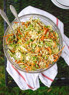 Asian Brussels Sprout Slaw with Carrots, Almonds, and Sesame Seeds - light, crunchy, and mayo-free. For this side dish, use tamari in the dressing and sweeten to taste with stevia.