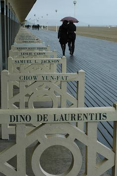 "Les planches de Deauville, notre ""Hollywood boulevard"" de la Seine ! Deauville is the 'Cannes' of Normandy with the American Film Festival, les planches( the boardwalk) casino, horse racing, beach  coastline. One of the most popular weekend getaways for fashion conscious Parisiens."