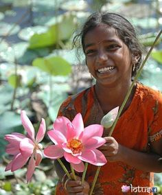 Lotus flowers and a beaming smile - India