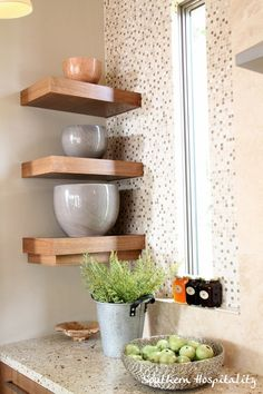 display shelves tucked into a corner space - it works!