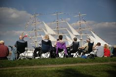 People watch as Polish tall ship Dar Mlodziezy passes through the Thames Barrier on September 9, 2014 in London, England. 50 ships have left London after the Tall Ships Festival - part of 'Totally Thames', a month long arts and cultural festival. (Photo by Peter Macdiarmid/Getty Images)