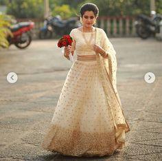 Kerala engagement dress - cream color for engagement Kerala Saree Blouse Designs, Half Saree Designs, Lehenga Designs, Indian Bridal Outfits, Indian Bridal Lehenga, Indian Dresses, Indian Sarees, Kerala Engagement Dress, Engagement Dress For Bride