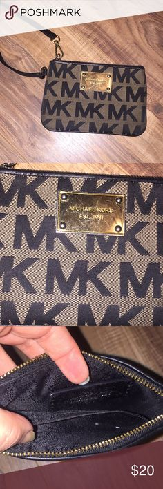 MK Michael Kors Coin Purse Wristlet Michael Kors Coin Purse Wristlet. Has some scratches on gold part (tried to get some pics!)  but looks new as far as the inside and on the MK part. Michael Kors Bags