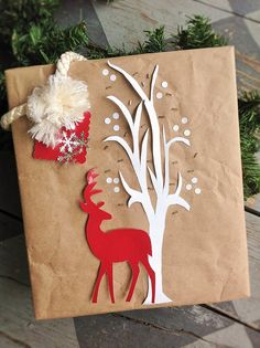 Red Deer Gift Wrap - glued buttons on the backside of deer silhouette to give it some field of depth.  And only glued trunk of tree and a few branches for that 3D look. http://www.pinterest.com/bethob/wrap-it-up-with-a-little-whimsy/