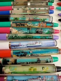 vintage souvenir novelty pens - my dad had one where if you tilted it, the woman's clothes came off.