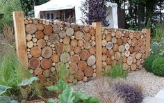 Cordwood fence.  Such a beautiful design for adding a bit of privacy to that special place in your yard.