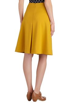 Start your outfit with this goldenrod-yellow skirt, and you'll surely finish it with a smile! This ModCloth-exclusive knit bottom by Myrtlewood features flattering reverse pleats and a sweet, subtle A-line cut - all the details you desire in a versatile skirt. Worn with a tucked-in top, bow-adorned heels, and charming novelty earrings, this piece has you feeling gleefully fashionable all day long!