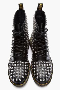 DR. MARTENS //  Black Leather Spike 8-Eye Boots  32399M047003  Leather boots in black. Round toe. Black lace up closure with silver tone eyelets. Silver cone studs throughout. Signature black and yellow logo pull loop at heel collar. Yellow top-stitched welt. Thick rubber foxing. Tonal stitching. Leather upper, rubber sole. Imported.  $390 CAD