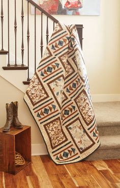 Make this cowboy bed-size quilt, On the Range by Heidi Pridemore, for a twin bed or use it as a large throw quilt in your den or guest room. The geometric design, combined with browns and blues, really speaks to the old West and country life. It's not just for cowboys though, cowgirls love it too!
