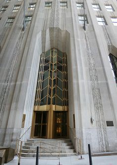 "1 Wall Street Building Financial District, Manhattan Constructed in as the corporate headquarters of the Irving Trust Company, this limestone faced skyscraper is situated on what was considered the ""most expensive real estate in New Yor Art Deco Stil, Art Deco Era, Art Deco Door, 1 Wall Street, Street Art News, Manhattan, Tower Design, Art Deco Buildings, New York Art"