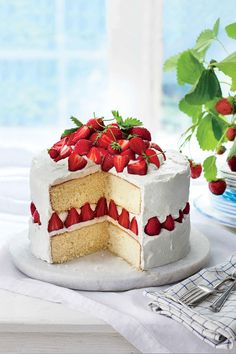 Strawberry Dream Cake | The perfect gift for the woman who taught you the secret to stiff peaks is all in the wrist. Treat Mama to a sweet slice of one of these stunning springtime cakes this Mother's Day. Keep things simple and easy with our Strawberries-and-Cream Sheet Cake, which you can make into a layered cake if you prefer. Moms that love cheesecake are going to flip over our Dreamy Lemon Cheesecake—you'll get bonus points if citrus is her favorite flavor.