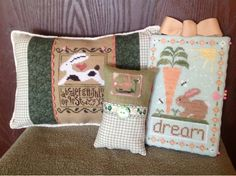 Group a selection of unrelated cross stitch bunny rabbit pillows to create an lovely display for Easter.