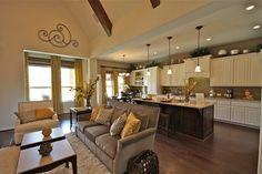 Love the island and cabinets--different colors and that the family room is open to the kitchen.