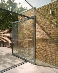in Hackney: it's week four in our celebration of design from the London borough of Hackney and today's featured project is a modest glass extension to a house in Dalston by Shoreditch-based architects Platform London Architecture, Architecture Design, Orangerie Extension, Glass Extension, Side Extension, Extension Ideas, Brick Garden, London Property, Pivot Doors