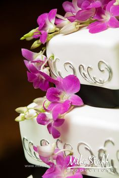 #wedding cake #wedding cake topper #tiered cake #Michigan wedding #Mike Staff Productions #wedding details #wedding photography http://www.mikestaff.com/services/photography #purple #flowers #white #black #silver