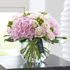 This heavenly display of luxurious Sweet Avalanches roses and classically stunning pink hydrangea is perhaps the epitome of natural beauty. We adore these delicate pink shades for their femininity and elegance. A fabuolous Wedding Anniversary Present | Booker Flowers and Gifts Liverpool