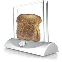 The transparent toaster lets you have a right toast. This amazing toaster works with transparent heating glass technology which allows you to see the bread while toasting. Now you can easily turn off the toaster once the bread has turned moderately brown. Cool Kitchen Gadgets, Cool Kitchens, Kitchen Tools, Kitchen Appliances, Kitchen Utensils, Kitchen Stuff, Funky Kitchen, Clever Gadgets, Kitchen Counters