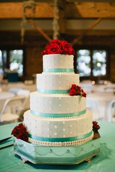 The unique color combination of Tiffany blue and red on this cake looks absolutely amazing! Check out more from our gorgeous weddings and events at www.idoidoweddingplanning.com!