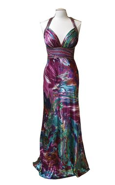Beaded accents along the halter and waist add texture to this otherwise purely satiny charmeuse gown. The artistic print is a mixture of abstract, tropical and tie-dye. The deep magenta and teal make the dress more mature than the typical high school look. It's a gown that says young adult. Cost: $229 at David's Bridal in Lower Paxton Twp. DAN GLEITER, The Patriot-News