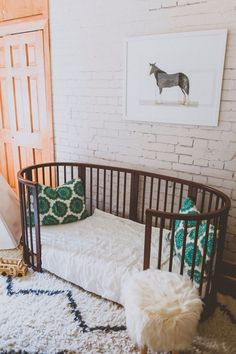 Love this nursery decor. The bed is realy cool and the horse illustration on the wall is nice!
