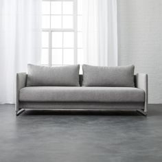 Shop tandom microgrid grey sleeper sofa.   Ingenious sleeper transforms from sofa to guest bed in clever 1-2-3 setup.  Modern design sits Euro-deep with oversized back cushions on polished metal tube frame.