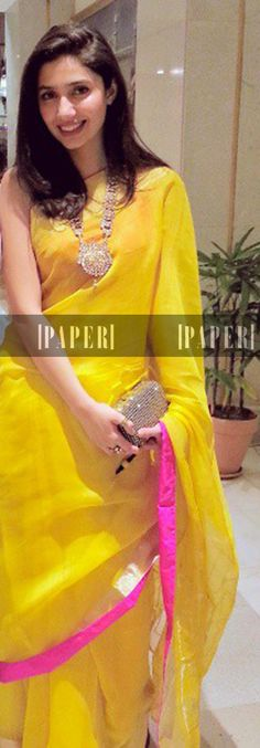Bright yellow saree with a hot pink border.