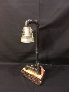 Insulator Pipe Lamp on Live Edge Base by WoodAndPipeArtisan on Etsy https://www.etsy.com/listing/564710486/insulator-pipe-lamp-on-live-edge-base
