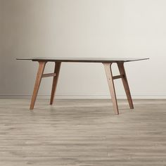 Features:  -10 mm Tempered smoked glass top.  -Rectangular.  -Walnut legs.  -Seats 6 people.  -South Bend collection.  Top Finish: -Smoked glass.  Base Finish: -Walnut.  Top Material: -Glass.  Base Ma