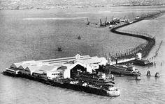 """Before the Bay Bridge the Key System trains ended on the """"mole"""" at the end of the landfill spit where they discharged their passengers who then boarded ferries to cross the Bay to San Francisco. San Pedro California, Oakland California, California History, San Francisco Bay, East Bay, Vintage Pictures, Public Transport, Bay Area, West Coast"""