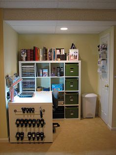 Craft room with IKEA desk.    I need this.