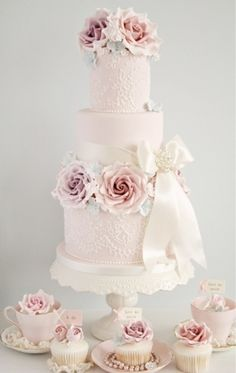 Vintage/Victorian wedding cake with purple for the icing roses  doesn't need to be tiers.