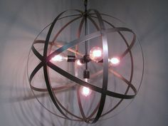 Reclaimed wine cask metal used to create spherical, genesa crystal lighting. Perfect for a barn or timberframe home.