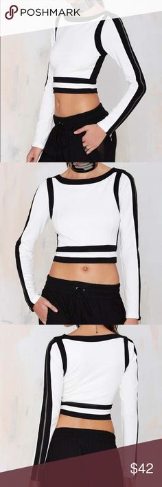 NEW Nasty Gal crop top STILL HAS TAGS!!!! Nasty gal black and white long sleeve crop top with zippers going down the arms. Stretchy and comfortable fit Nasty Gal Tops Crop Tops