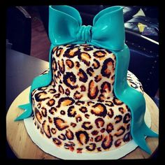 Leopard cake with a teal bow.