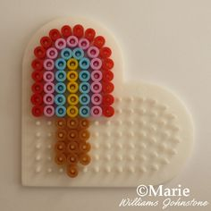 Cute mini rainbow color popsicle made with a heart shape peg board and fused Perler or Hama beads. Easy Perler Bead Patterns, Melty Bead Patterns, Diy Perler Beads, Bead Embroidery Patterns, Perler Bead Art, Pearler Beads, Beading Patterns, Loom Patterns, Bracelet Patterns