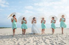 How adorable is this?! We also love the mint chiffon A-line bridesmaids dresses with one-shoulder necklines. {@dkpullen}