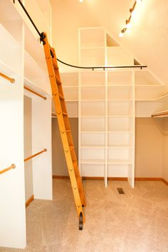 bottom to ceiling white melamine walk in closet idea with movable wooden ladder with railing system support of Dozens of Walk In Closet Organizers Lowes