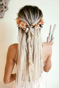 Beautiful Hairstyle With Boho Braids and Floral Hair Accessories