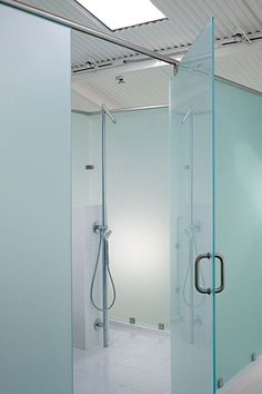 The bathroom is a glass box in the center of the renovated space